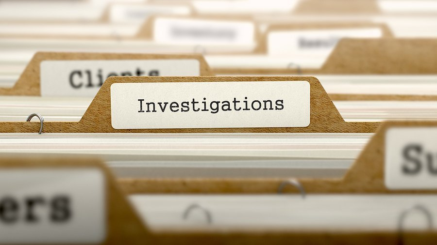 Investigations folder for a security fraud case in Milwaukee
