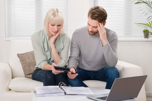 couple calculating business bankruptcy tax